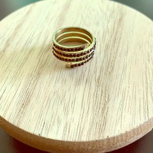 Gold spiral ringworm black stones